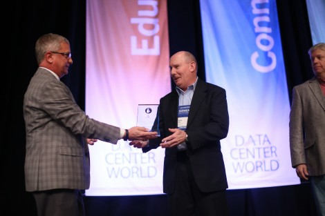 AFCOM President Tom Roberts presents an award to Bryon Miller, SVP of operations at Fortrust. Miller was one of the three finalists in this year's Data Center Manager of the Year awards.